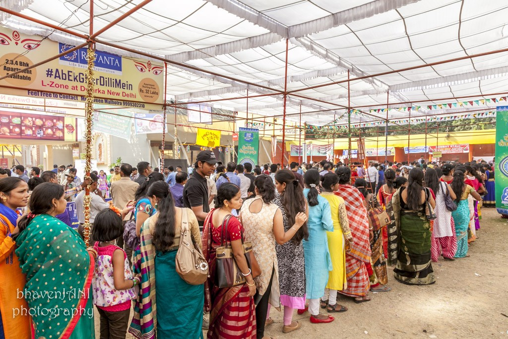 Long queues at the B-block Durga puja grounds, for the prasad comprising khichdi & aloo subzi