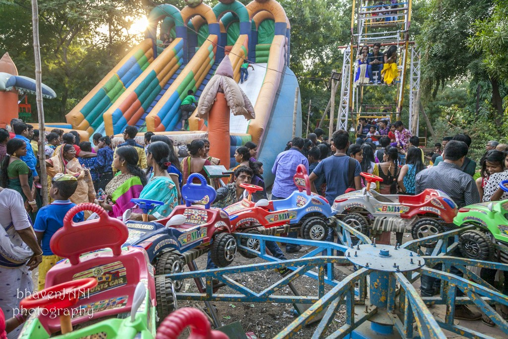 Kids have fun at the carnival ground in Kali Mandir