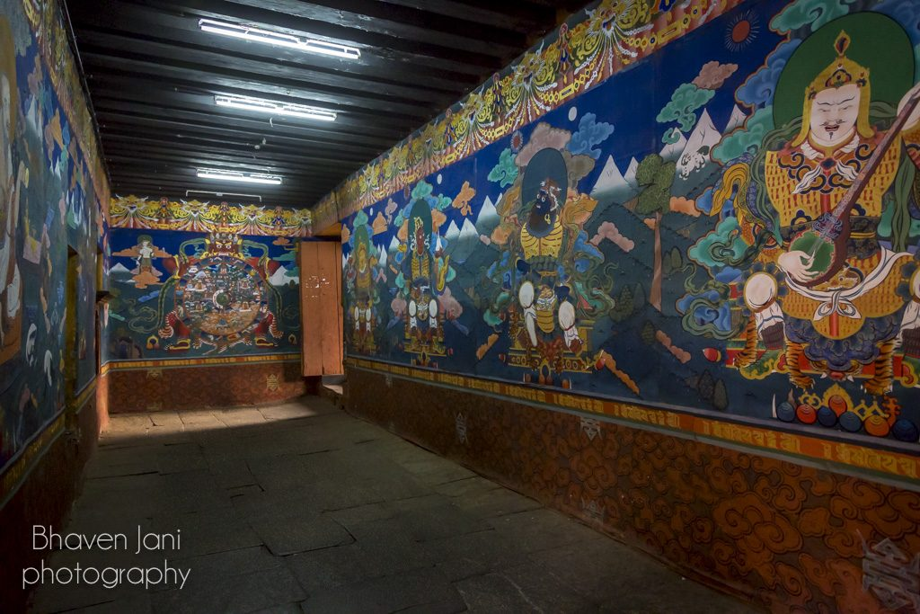 Detailed Buddhist paintings inside Paro Dzong